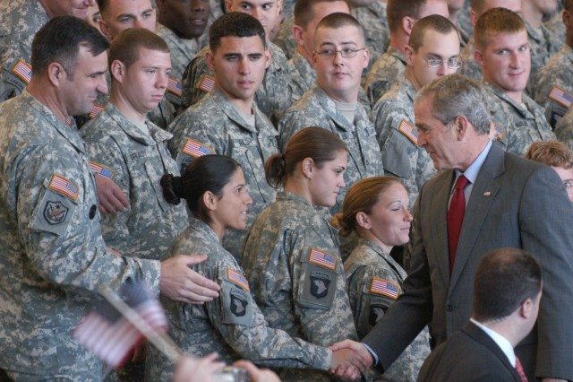 """The President shakes hands with Soldiers at Fort Campbell, Ky. during his Nov. 25 visit to the installation. Bush congratulated Soldiers of the 101st Airborne Division, 160th Special Operations Aviation Regiment, and 5th Special Forces Group for a """"job well done."""""""
