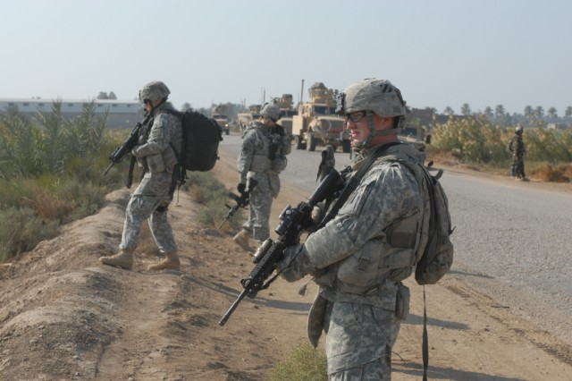 U.S. and Iraqi Soldiers patrol a street near Mahawil in northern Babil Province during Operation Slap, Nov. 24. The two-day, Iraqi Army-led operation aimed to disrupt IED cells and find suspected insurgents in the area.