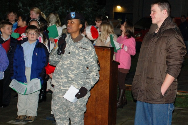 Lt. Col. Fern Sumpter, USAG Schinnen Commander, introduces Eric Orth, Tri-Border Youth of the Year during the annual Tree Lighting Ceremony at USAG Schinnen.
