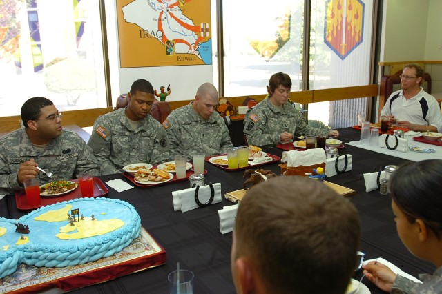 Country music singer Tracy Lawrence has lunch with about 20 Soldiers from the 15th Sustainment Brigade, 13th Sustainment Command (Expeditionary), Dec. 3 at the Freedom Café Dining Facility. The singer was visiting Fort Hood for a CD signing and took the opportunity to have lunch with a few Soldiers.