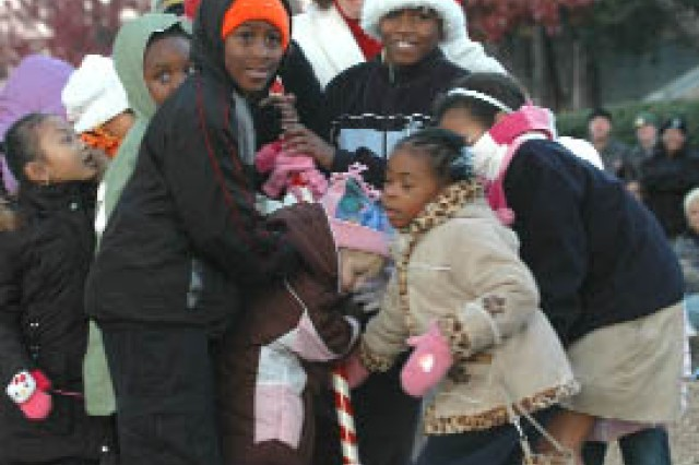 With unbridled anticipation, the youths in the crowd help Dianne Campbell, wife of Gen. Charles C. Campbell, commander, FORSCOM, pull the candy-cane switch to light the tree.