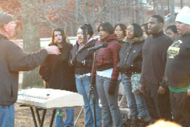 As part of the ceremony, about 40 students from the Morrow High School's Mustang Chorus serenade the crowd with seasonal music.