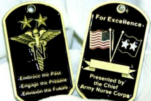 "The Chief of the Army Nurse Corps has a new challenge coin featuring the theme of the corps for the next four years, ""Embrace the Past, Engage the Present and Envision the Future.""  The coin, based on the look of dogtags, and theme were devised by Maj. Jerramie Siegfried of Tripler Army Medical Center."