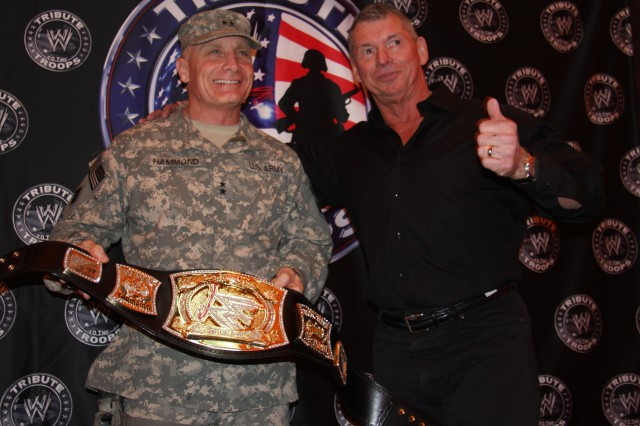 CAMP VICTORY, Iraq - Maj. Gen. Jeffery Hammond, a Hattisburg, Miss. native, commanding general, Multi-National Division - Baghdad, poses with Vince McMahon, World Wrestling Entertainments chairman, before the WWE wrestlers took the ring during the Tribute to the Troops Tour held in front of the Al Faw Palace on Dec. 5.