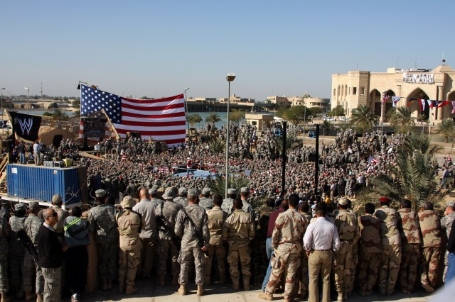 CAMP VICTORY, Iraq - Troops from all over the Victory Base Complex gathered to cheer for their favorite World Wrestling Entertainment wrestlers at the Tribute to the Troops Tour held in front of the Al Faw Palace on Dec. 5.