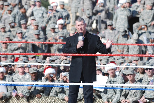 BAGHDAD, Iraq - Vince McMahon, chairman of the World Wrestling Entertainment speaks to Multi-National Division - Baghdad and 4th Infantry Division Soldiers during the World Wrestling Entertainment Inc.'s Tribute to the Troops Tour in front of the Al Faw Palace on Camp Victory Dec. 5. The event marks the sixth year in a row that WWE superstars have come to entertain U.S. troops stationed on the front lines in Iraq.