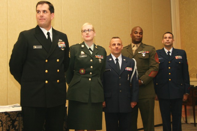 Sgt. Alicia Hight, (center left) the 2008 U.S. Army Enlisted Aide of the Year, stands with enlisted aides of the other military service branches during the Inter-Service Enlisted Aide of the Year competition in Washington, D.C., Nov. 18. Hight, assigned to the US Army Sustainment Command, Rock Island Arsenal, Ill., was the Army's nominee for the inter-service award hosted by the USO.
