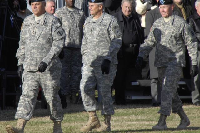 Gens. William S. Wallace, outgoing TRADOC commander; George W. Casey Jr., Army chief of staff; and Martin E. Dempsey, incoming TRADOC commander, march onto the field for the change of command ceremony Dec. 8 at Fort Monroe, Va. (Photo by Frank Brown)