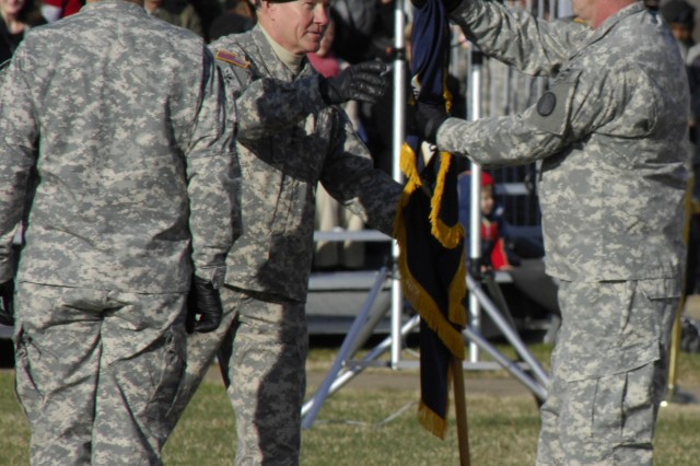 New TRADOC commander Gen. Martin E. Dempsey passes the TRADOC colors to TRADOC's Command Sgt. Maj. David M. Bruner as Dempsey assumes command of TRADOC. (Photo by Frank Brown)