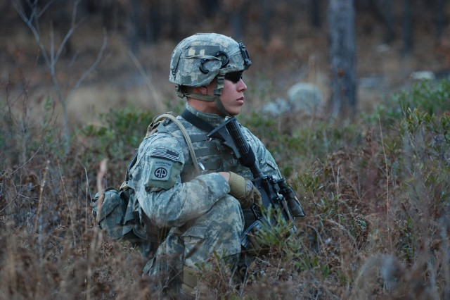 Sgt. Aaron Atchison, of C Company, 2nd Battalion, 325th Airborne Infantry Regiment, 2nd Brigade Combat Team, 82nd Airborne Division, pulls security during movement to assault an objective as part of a live fire exercise at Fort Bragg Dec. 5.