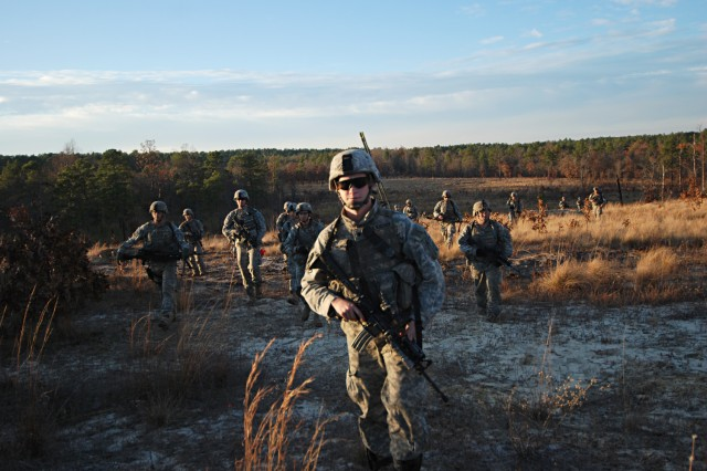 Smithfield, Maine native Spc. Nathan Landry, a radio operator with C Company, 2nd Battalion, 325th Airborne Infantry Regiment, 2nd Brigade Combat Team, 82nd Airborne Division, steps it out as his platoon moves to assault an objective as part of a live fire exercise at Fort Bragg Dec. 5.