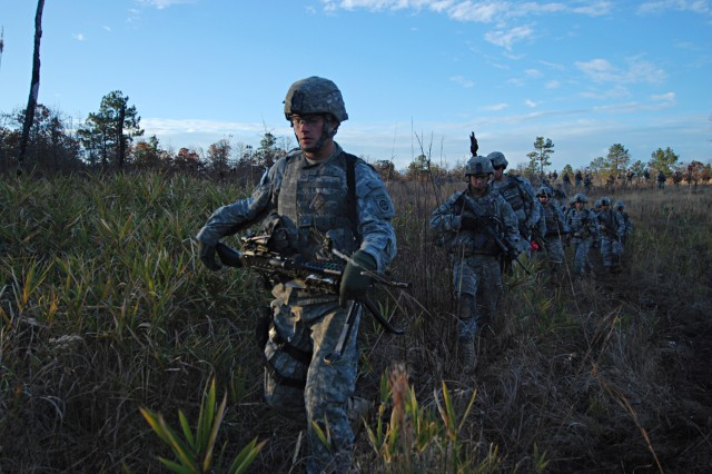 Paratroopers from C Company, 2nd Battalion, 325th Airborne Infantry Regiment, 2nd Brigade Combat Team, 82nd Airborne Division, conduct a movement through the Fort Bragg woods to assault an objective as part of a live fire exercise Dec. 5.