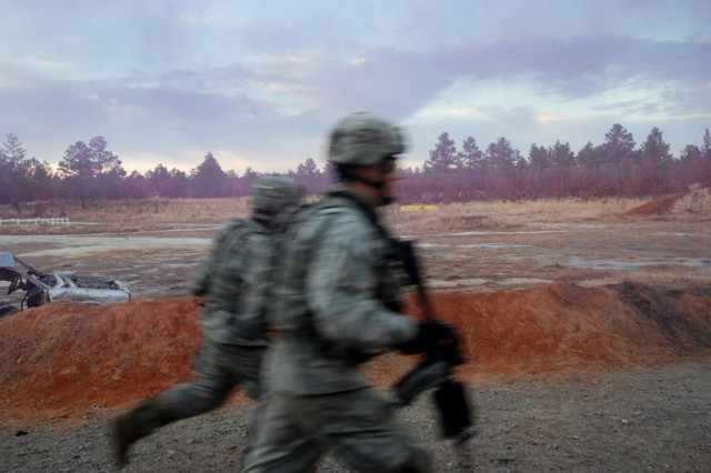 Paratroopers from 2nd Battalion, 325th Airborne Infantry Regiment, 2nd Brigade Combat Team, 82nd Airborne Division, race past as they assault an objective during a live fire exercise at Fort Bragg Dec. 5.