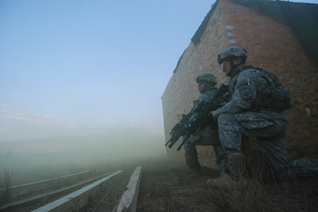 Dust and smoke settle around Paratroopers from C Company, 2nd Battalion, 325th Airborne Infantry Regiment, 2nd Brigade Combat Team, 82nd Airborne Division, as they pull security after assaulting an objective during a live fire exercise Dec. 5.