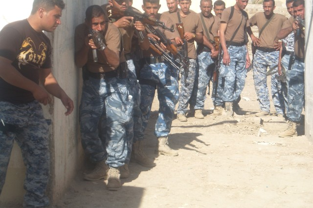 A team of Iraqi police officers train on urban tactics in the Dhi Qar province. ""