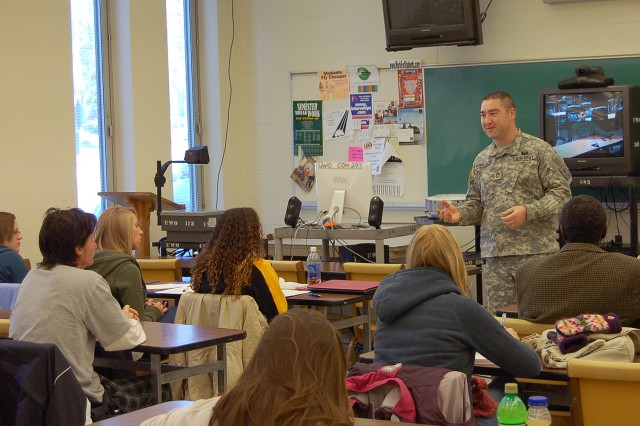 OSHKOSH, Wis. - Sgt. 1st Class Joseph McGuigan, a recruiter stationed at Oshkosh, introduces Capt. Conrad Jakubow, 96th Civil Affairs Battalion, before speaking from Fort Bragg, N.C., Thursday, Dec. 4. Jakubow shared his deployment experience as a civil affairs officer in Afghanistan to students at the University of Wisconsin Oshkosh. Photo by Jorge Gomez.