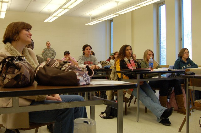 "OSHKOSH, Wis. - Students from a class called ""Globalization and Human Services"" at the University of Wisconsin Oshkosh listen to a presentation Thursday, Dec. 4, by Capt. Conrad Jakubow, 96th Civil Affairs Battalion, through video teleconferencing from Fort Bragg, N.C. Photo by Jorge Gomez."