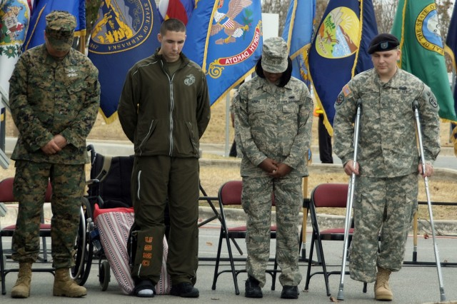 Servicemembers bow their heads during the groundbreaking ceremony Monday for the San Antonio Military Medical Center which will combine Air Force and Army hospitals there.