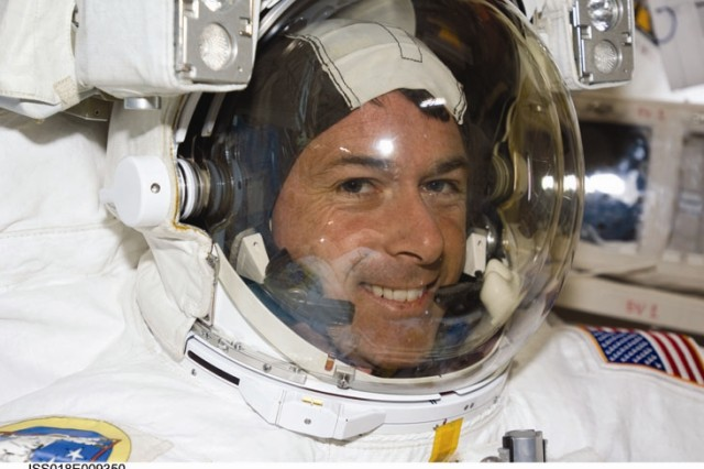 Astronaut Shane Kimbrough, STS-126 mission specialist, attired in his Extravehicular Mobility Unit (EMU) spacesuit, awaits the start of the mission's second scheduled session of extravehicular activity (EVA) in the Quest Airlock of the International Space Station.