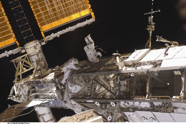 Astronaut Shane Kimbrough, STS-126 mission specialist, participates in the mission's second scheduled session of extravehicular activity (EVA) as construction and maintenance continue on the International Space Station. During the six-hour, 45-minute spacewalk, Kimbrough and astronaut Heidemarie Stefanyshyn-Piper (out of frame), mission specialist, continued the process of removing debris and applying lubrication around the starboard Solar Alpha Rotary Joint (SARJ), replaced four more of the SARJ's 12 trundle bearing assemblies, relocated two equipment carts and applied lubrication to the station's robotic Canadarm2.