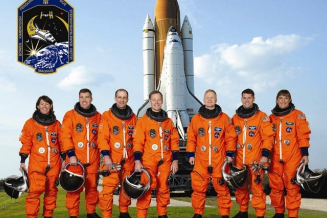 Attired in training versions of their shuttle launch and entry suits, these seven astronauts take a break from training to pose for the STS-126 crew portrait. Astronaut Christopher J. Ferguson, commander, is at center; and astronaut Eric A. Boe, pilot, is third from the right. Remaining crewmembers, pictured from left to right, are astronauts Sandra H. Magnus, Stephen G. Bowen, Donald R. Pettit, Robert S. (Shane) Kimbrough and Heidemarie M. Stefanyshyn-Piper, all mission specialists. Magnus is scheduled to join Expedition 18 as flight engineer after launching to the International Space Station on mission STS-126.