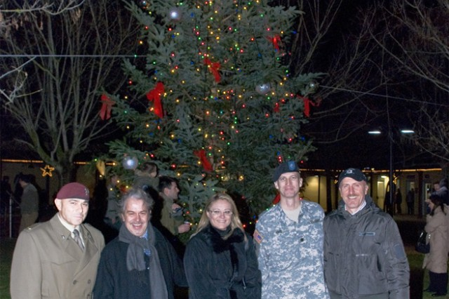 From left: Col. Raffaele Iubini, Italian base commander, Marco Onori, Pistoia province consular, Sonia Bartolini, Pistoia province consular, Lt. Col. Steven Cade, U.S. Army Garrison Livorno commander and Nicola Risaliti, Pistoia province tourist consular, pose in front of a Christmas tree donated by the Pistoia province to Camp Darby, Italy, Dec. 5. Pistoia has been donating a tree to Camp Darby since the 9-11 terrorist attacks as a gesture of goodwill.