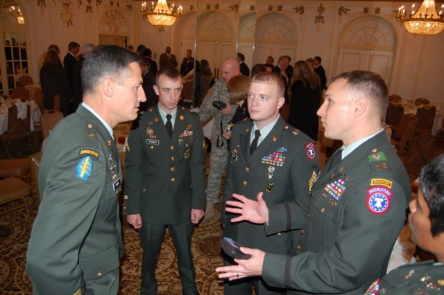 Brig. Gen. Kenneth E. Tovo (left), deputy commander, Special Operations Command - Europe, talks with Soldiers Dec. 9, 2008, at the Peabody Hotel in Memphis, Tenn.  The general was honored with the 2008 AutoZone Liberty Bowl's Distinguished Citizen Award during a ceremony at the hotel.