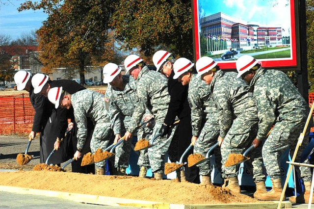 Lt. Gen. Jack C. Stultz (fourth from the left), commander, U.S. Army Reserve Command (USARC), and Gen. Charles C. Campbell (fifth from left), commander, U.S. Army Forces Command (FORSCOM), are flanked by other Army, state and local officials during the groundbreaking ceremony held Dec. 8 at Fort Bragg, N.C. The site marks where the new headquarters building, which will house FORSCOM and USARC, will be when it\'s completed in 2011.