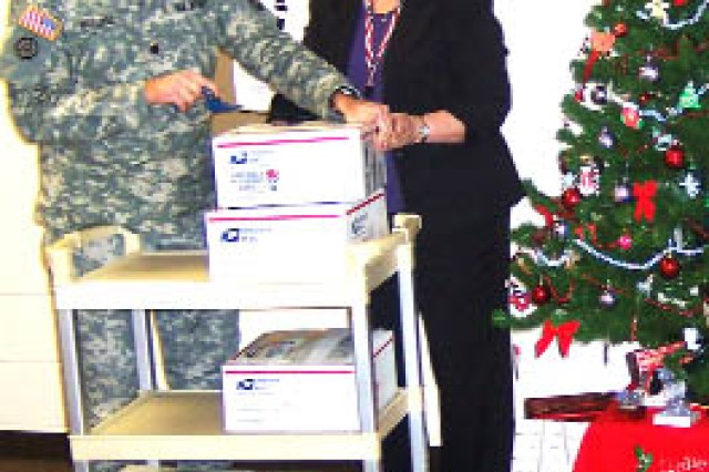 Co-workers help dad send holiday cheer to Afghanistan