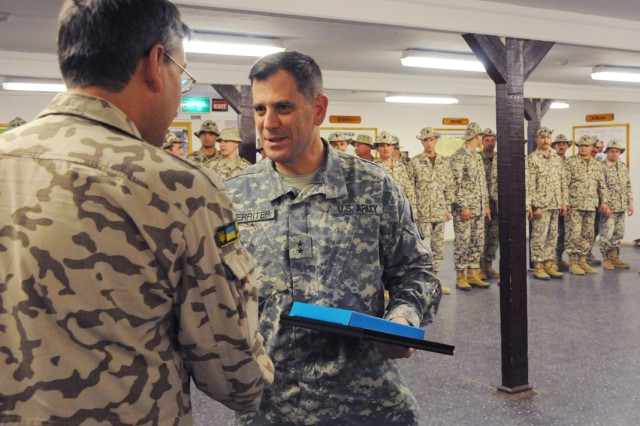 Viktor Nedopas, Charge dAca,!a,,cAffairs of the Ukrainian Embassy in Iraq, presents a certificate and gift to Maj. Gen. Michael Ferriter, deputy commanding general for operations, MultiNational Corps-Iraq.