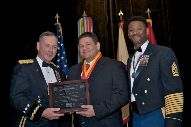 The Installation Management Command honored the Stalwart Award nominees and winners during a banquet and awards ceremony Dec. 10 at the Loews Coronado Bay Resort in San Diego, Calif. These individuals excelled in support of the Army, Soldiers and their Families from July 2007 to July 2008.   From left: Lt. Gen. Robert Wilson, commanding general, Installation Management Command; Terry K. McMaster, fire chief, USAG Rock Island Arsenal, Mich.; and Command Sgt. Maj. John M. Gaines, Jr.