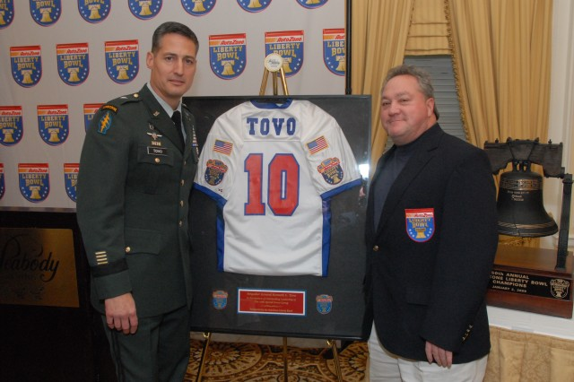 Brig. Gen. Kenneth Tovo was named 2008 AutoZone Liberty Bowl Distinguished Citizen Award, Dec. 9, during a ceremony at the Peabody Hotel, Memphis, Tenn. AutoZone Liberty Bowl supporter, Mike Bowen, discussed the football jersey presented to the