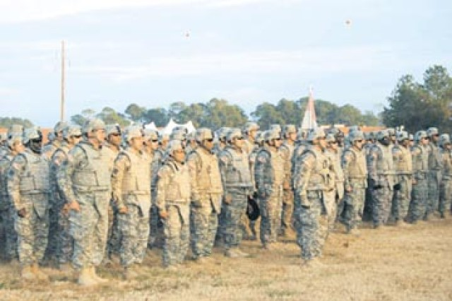 """Soldiers from 4th BCT sing the """"Dog Face Soldier"""" song before their eager Family Members rushed the field, Dec. 6."""