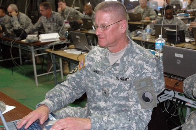 Brigadier Gen. Peter C. Hinz monitors communications from his units on the simulated battlefield using his laptop workstation in the 29th Division Tactical Operation Center.""