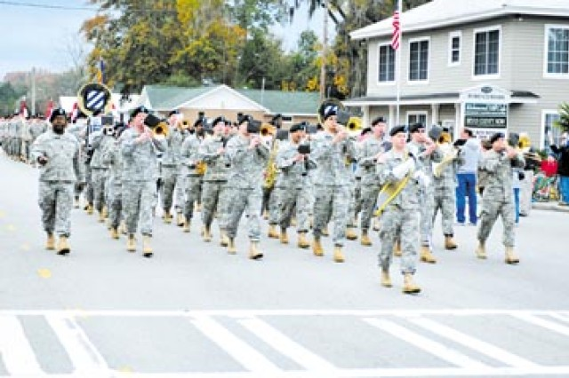 Members of the 3rd ID Band followed Maj. Gen. Tony Cucolo, 3rd ID commander, and Command Sgt. Maj. Jesse Andrews, 3rd ID command sergeant major, and preceded more than 80 Soldiers from 3/7 Cav. Regt., 2nd BCT, who marched in the Richmond Hill Hometown Festival Parade on U.S. Highway 144, Dec. 6.