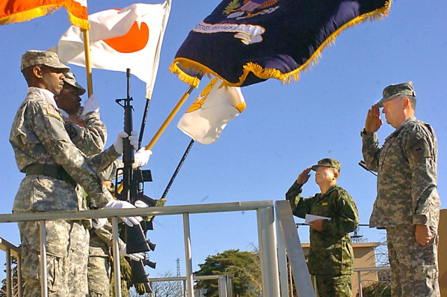 Lt. Gen. Benjamin R. Mixon, U.S. Army, Pacific commander, and Japan Lt. Gen. Kazushi Izumi, commander Japan Ground Self Defense Force Eastern Army, salute the colors during the playing of their nation's national anthems at the opening ceremony for Yama Sakura 55, Dec. 7, 2008, on the grounds of the JGSDF Transportation School.