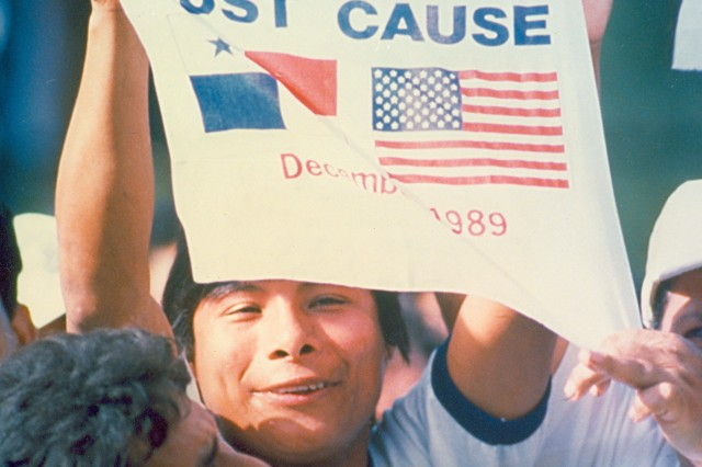 """Image shows a Panamainian citizen flaunting a """"Just Cause"""" insignia in protest against General Noriega (Panama Photograph Collection)."""