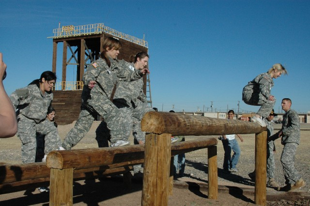 Spouses of 6th Squadron, 1st Cavalry Regiment, servicemembers tackle the hurdles during the spur ride event Saturday