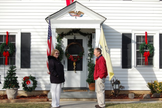 Roop and McGlothlin admire Christmas decorations at one of the Staff Village housing units.  Christmas decorating contests are just one of the many family activities enjoyed by members of the complex.