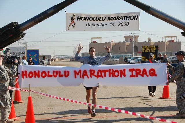 Maj. Kurt Kinney, a Utica, N.Y. native, finishes the Satellite Honolulu Marathon in a time of 3:04:02 on Dec. 14. The satellite marathon was run 8,000 miles away and twelve hours ahead of the Honolulu Marathon.  (U.S. Army photo by Maj. Al Hing, 2nd SBCT PAO)