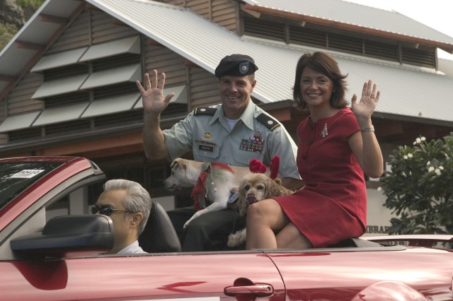 ALIAMANU MILITARY RESERVATION, Hawaii - Lt. Col. Mark Boussy, commander, U.S. Army Garrison-Oahu along with his wife, Sara wave to the crowd during the parade to kick-off the 12th annual Holiday Fun Fest, held at Aliamanu Military Reservation, Dec. 6.