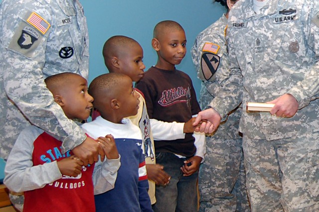USAREC Command Sgt. Maj. Stephan Frennier thanks Sgt. 1st Class Charles Moore and his sons Eric, Joshua, Jordan and Jaylen for their participation in USAREC's Army Family Covenant signing ceremony Dec. 15 on Fort Knox.