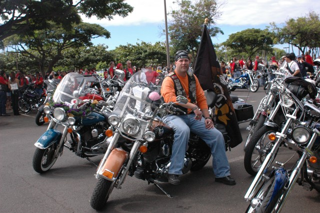 WAIKIKI, Hawaii - Sgt. 1st Class Chris Laye, military police operations sergeant, Schofield Barracks, and director, Honolulu Harley Owners Group, prepares to mount up at the parade, Sunday.