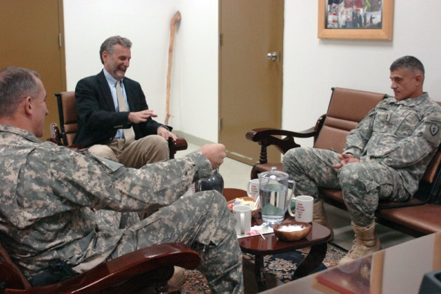 Thomas C. Krajeski, senior advisor for northern affairs to the U.S. Ambassador to Iraq, sits down with Maj. Gen. Robert L. Caslen Jr., Commander, Multi-National Division - North, and Brig. Gen. Robert B. Brown, Deputy Commanding General - Support, MND-N, at Contingency Operating Base Speicher near Tikrit, Iraq, Dec. 16, to welcome Task Force Lightning and discuss past and future plans for northern Iraq.