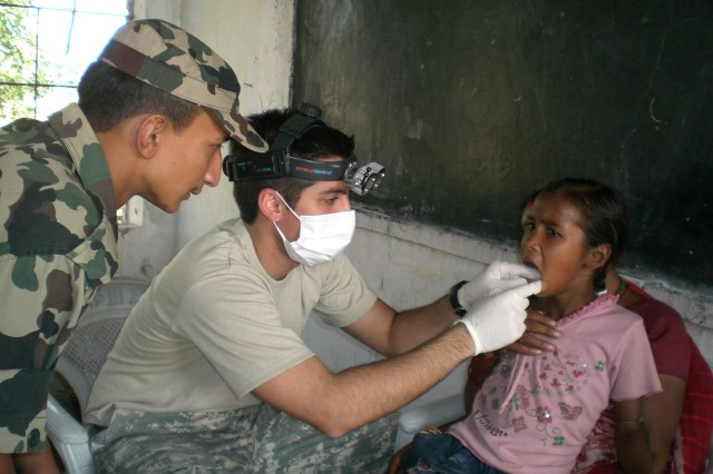 CPT Raeza Sharifi (Dentist) prepares a patient for an extraction.