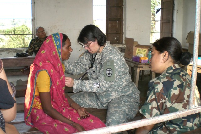 CPT Susanna Holt (Family Physician) checks the vital on a Nepalese local national.
