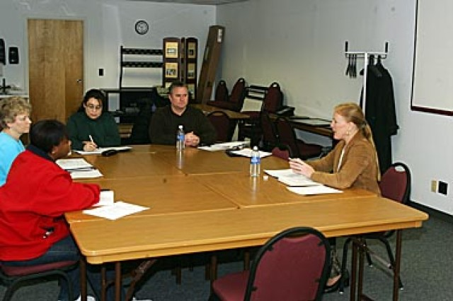 Kathleen Olson (right), an employment and training specialist for KO Employment and Consulting, presents a Resume Writing Workshop at Army Community Service (ACS). ACS sponsored the Dec. 4 workshop to help personnel put together or make improvements to an existing resume to help them get the job they wanted.