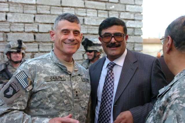 """Hamood Shekti al Qaisi, Salah Ad Din Provincial Governor, meets with Maj. Gen. Robert L. Caslen Jr., commander, Multi-National Division - North, at the conclusion of Iraqi radio call-in show """"Special Interviews"""" Dec. 17 in Tikrit, Iraq. Callers asked the prominent northern - Iraq figures many questions concerning past and future goals for the Salah Ad Din province."""