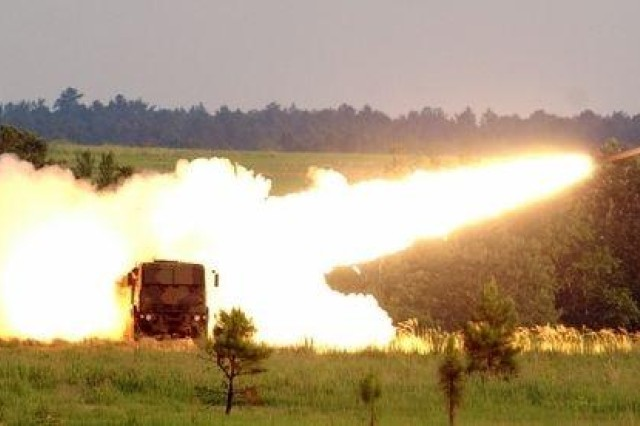 An M 31, Guided Multiple Launch Rocket heads downrange following launch from a High Mobility Artillery System.
