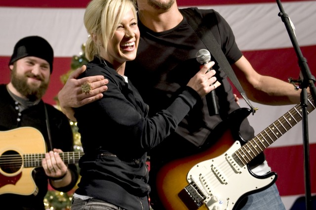Grammy award winning musician Kid Rock, American Idol contestant and country musician Kellie Pickler and musician Zack Brown entertain troops stationed at Kandahar, Afghanistan during the 2008 USO Holiday Tour. Tour host Navy Adm. Mike Mullen, chairman of the Joint Chiefs of Staff, along with his wife Deborah, welcomed comedians John Bowman, Kathleen Madigan and Lewis Black; actress Tichina Arnold on the tour bringing music and entertainment to service members and their families stationed overseas.